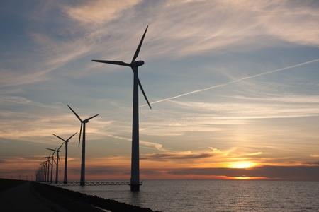 Dutch offshore windturbines during a beautiful sunset 免版税图像