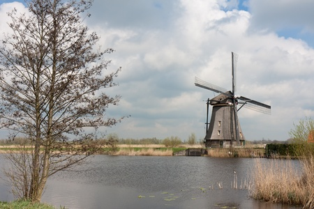 watermanagement: Beautiful traditional windmill in springtime, Kinderdijk, the Netherlands