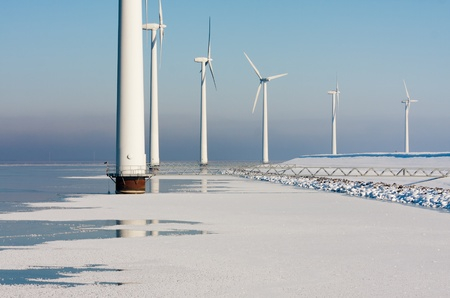 Dutch offshore windturbines in a frozen sea Stock Photo - 12164385