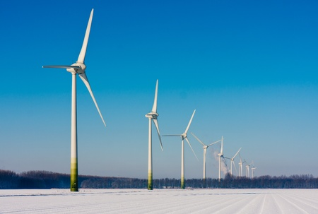 Rural winter landscape in the Netherlands with big windturbines photo