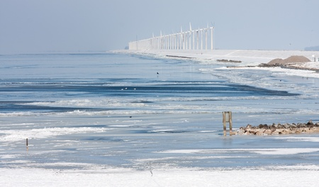 Dutch winter seascape with big farm of windturbines photo