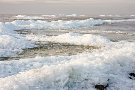 Ice hummocks by sunset in the Netherlands photo