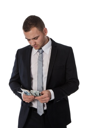Businessman is counting money; isolated on white photo