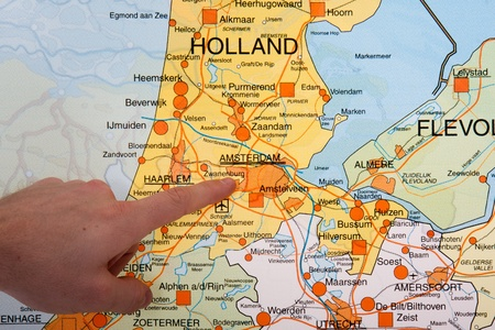 A Dutch map with a hand pointing to the capital city Amsterdam Stock Photo - 12625111