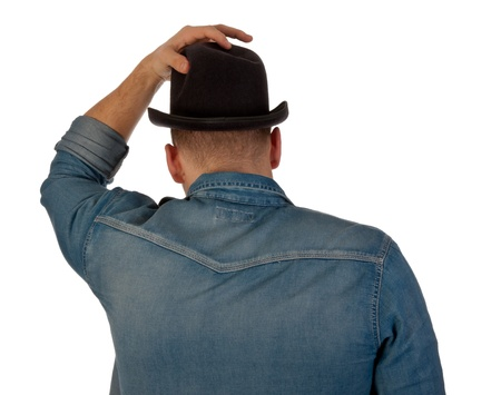 Rear view of a young man with a bowler against a white background photo