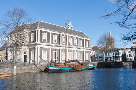 schiedam: Traditional wooden barge in old historic harbor of Schiedam, The Netherlands