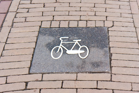 Bicycle sign on a Dutch brick road photo
