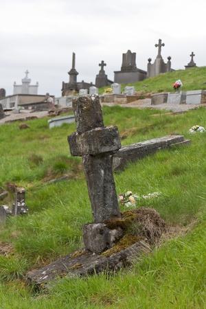 churchyard: Old cross at a Belgium cemetery