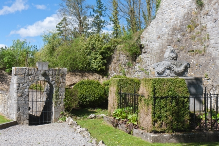 Ornamental garden near an old castle ruins