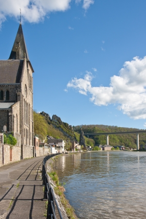 wallonie: Sidewalk along the river Meuse in Dinant, Belgium Stock Photo