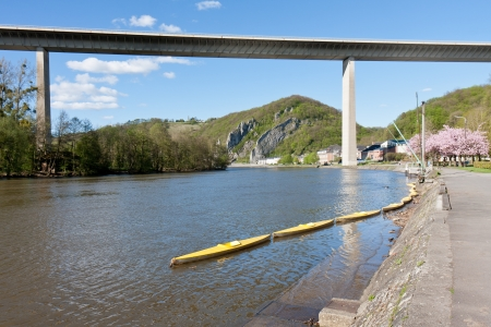 River Meuse near Dinant in Belgium, a highway is crossing te river photo