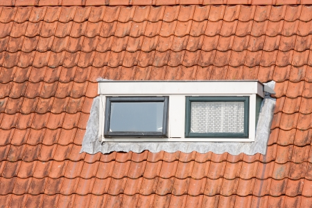 Typical Dutch roof with dormer and squared windows Stock Photo - 14334784