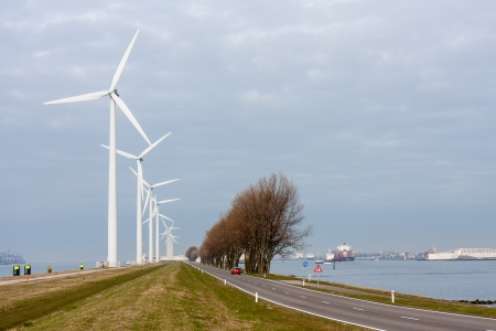 Windturbines in harbor of Rotterdam, the Netherlands photo