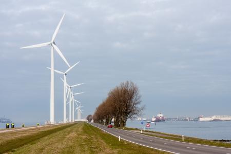 Windturbines in harbor of Rotterdam, the Netherlands photo