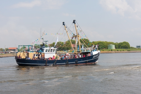fisheries: URK, THE NETHERLANDS - MAY 19: A decorated fishing ship is leaving the harbor during a National fisheries festival
