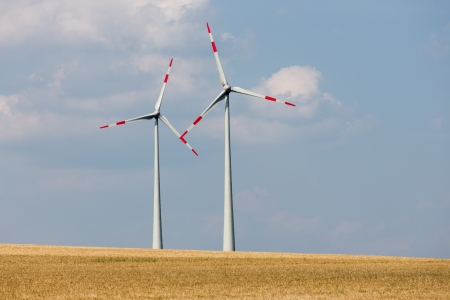 Two big wind turbines in the farmland of Germany photo