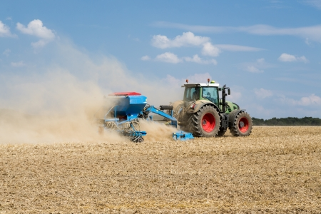 seed drill: Tractor with a sowing machine working in the field