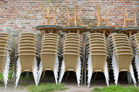 Heap of chairs and tables, ready for use at the outdoor terrace photo