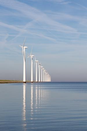 Dutch offshore wind turbines in a calm sea photo