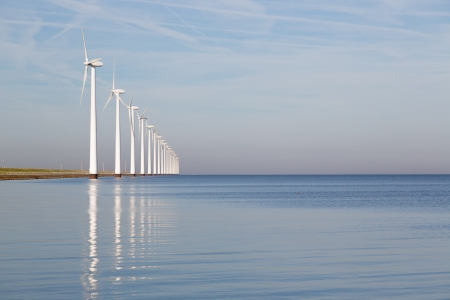 Dutch offshore wind turbines in a calm sea photo