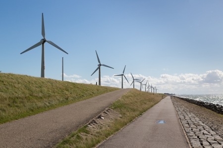 windturbines: Windturbines along a Dutch dike near Urk Stock Photo
