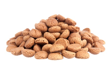 A big pile of ginger nuts on a white background.