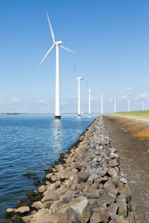 dike: Off shore wind turbines in the Netherlands Stock Photo