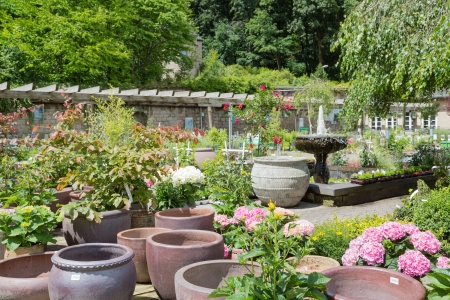 Garden center with big stone flower pots Stock Photo