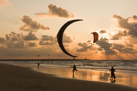 Kitesurfing in the evening at a Dutch beach photo