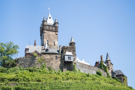 mosel: Cochem castle in Germany, surrounded by vineyards Editorial