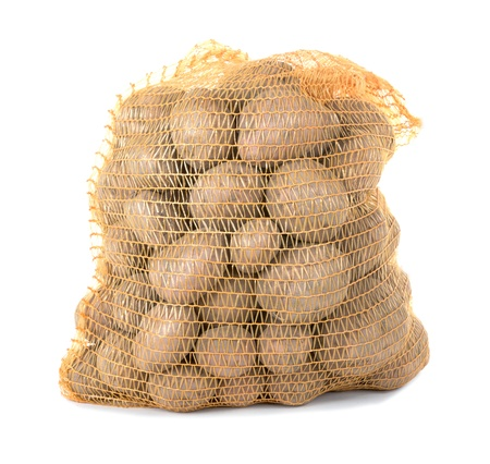 Potatoes in a bag over a white background