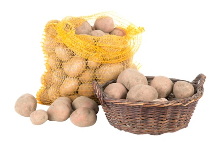 Potatoes in a bag and a basket photo
