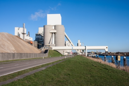 Big cement factory near a canal in the Netherlands