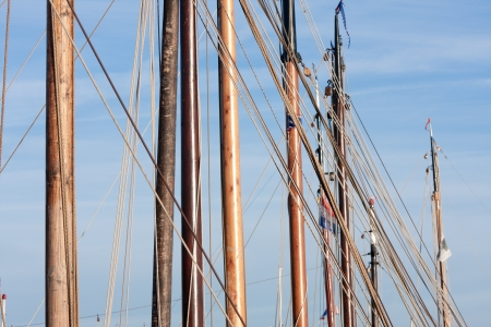 Masts and rigging from old wooden sailing ships photo
