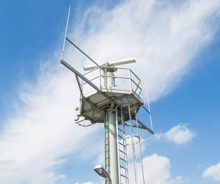 Radar installation against a blue sky photo