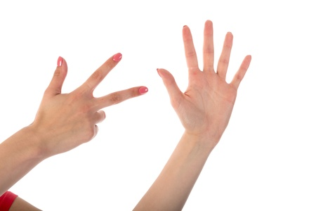 Female hands showing eight fingers isolated on white background photo