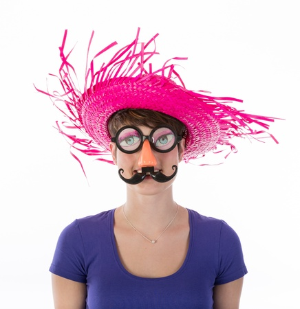 Woman with funny carnival mask and hat Stock Photo