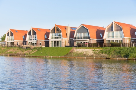 Small houses along a Dutch channel Stock Photo