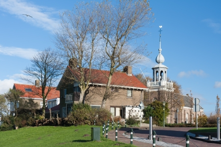 Church and houses of Urk, an old Dutch fishing village photo