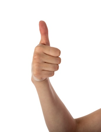 Female hand showing thumb up isolated over white photo