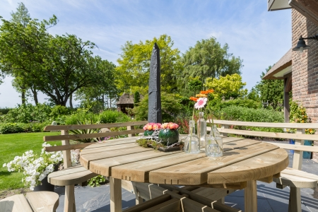 Garden with wooden bench and table