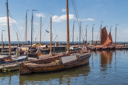 Dutch harbor of Urk with traditional wooden fishing boats photo