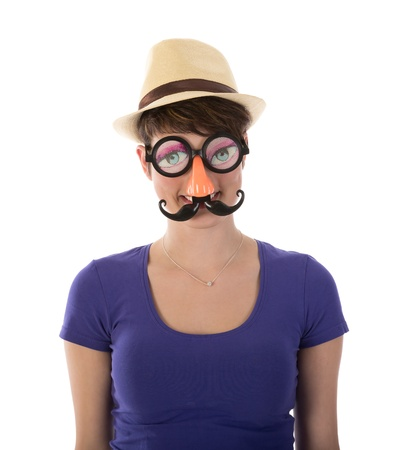 Pretty woman with funny mask and hat photo