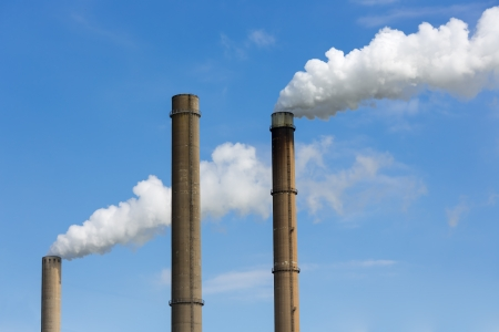Industrial smoke stacks of a power plant  photo