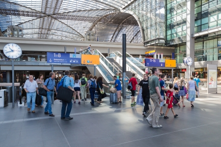 BERLIN, GERMANY - JULY 22  Tourists and workers are shopping and traveling at the central station of Berlin on July 22, 2013 in the central station of Berlin, Germany