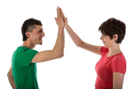 Man and woman giving a high five isloated on white photo