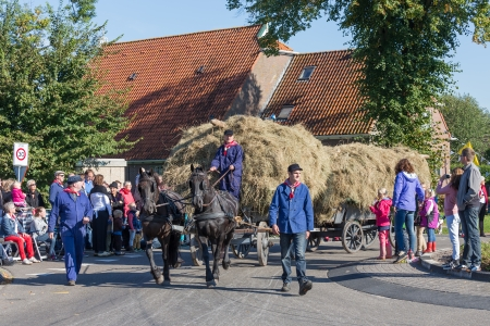 NIEUWEHORNE, THE NETHERLANDS - SEP 28  Farmers with a traditional hay-wagon in a countryside parade during the agricultural festival Flaeijel on September 28, 2013, the Netherlands
