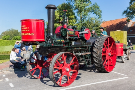 NIEUWEHORNE, THE NETHERLANDS - SEP 28  Old steam tractor in a countryside parade during the agricultural festival Flaeijel on September 28, 2013, the Netherlands