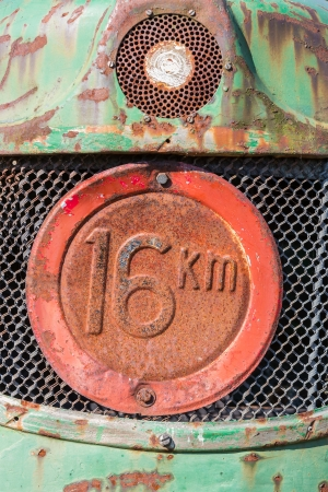 tractor warning sign: Front view of an old tractor with maximum speed sign Stock Photo