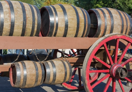 old wood farm wagon: Wooden barrels at an old farm wagon in a countryside parade